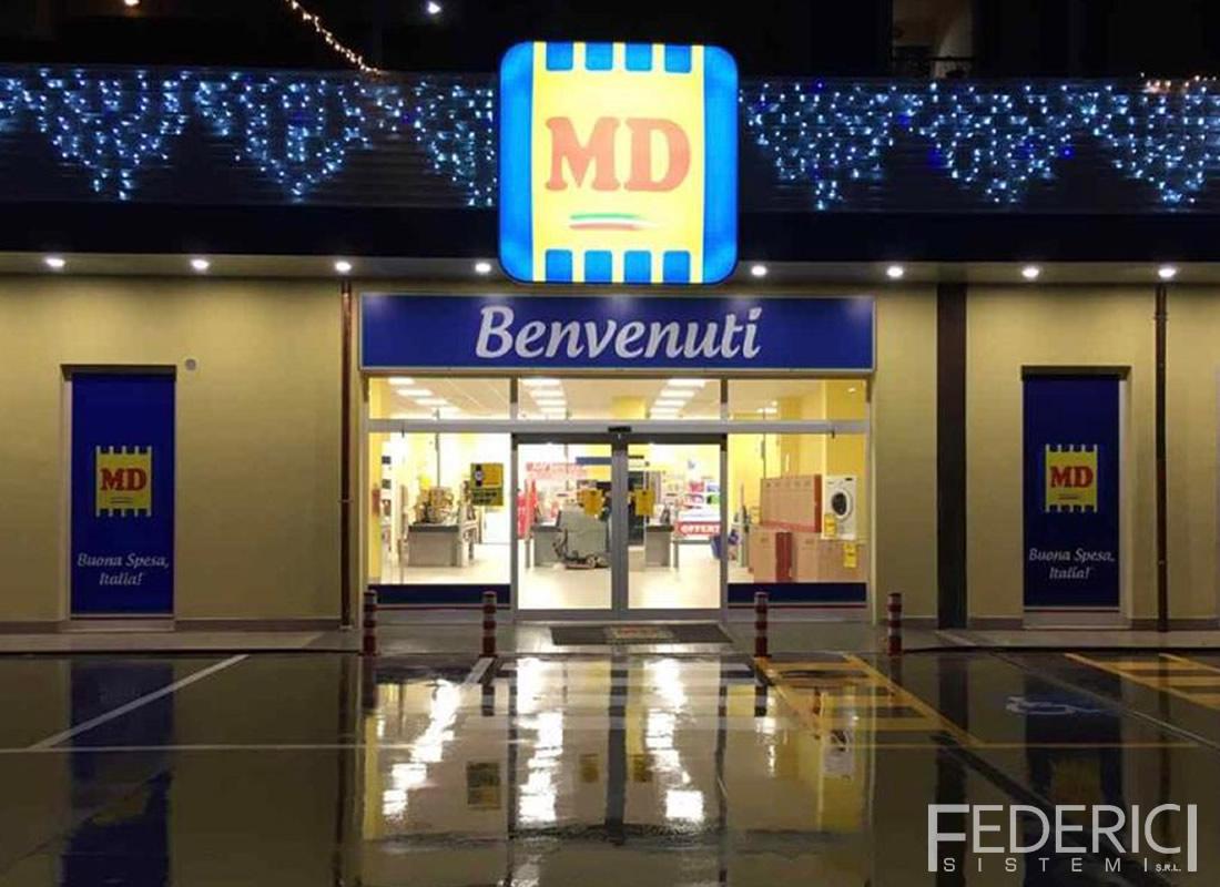 Supermercato MD. Infissi (completi di ingresso scorrevole) realizzati da Federici Sistemi